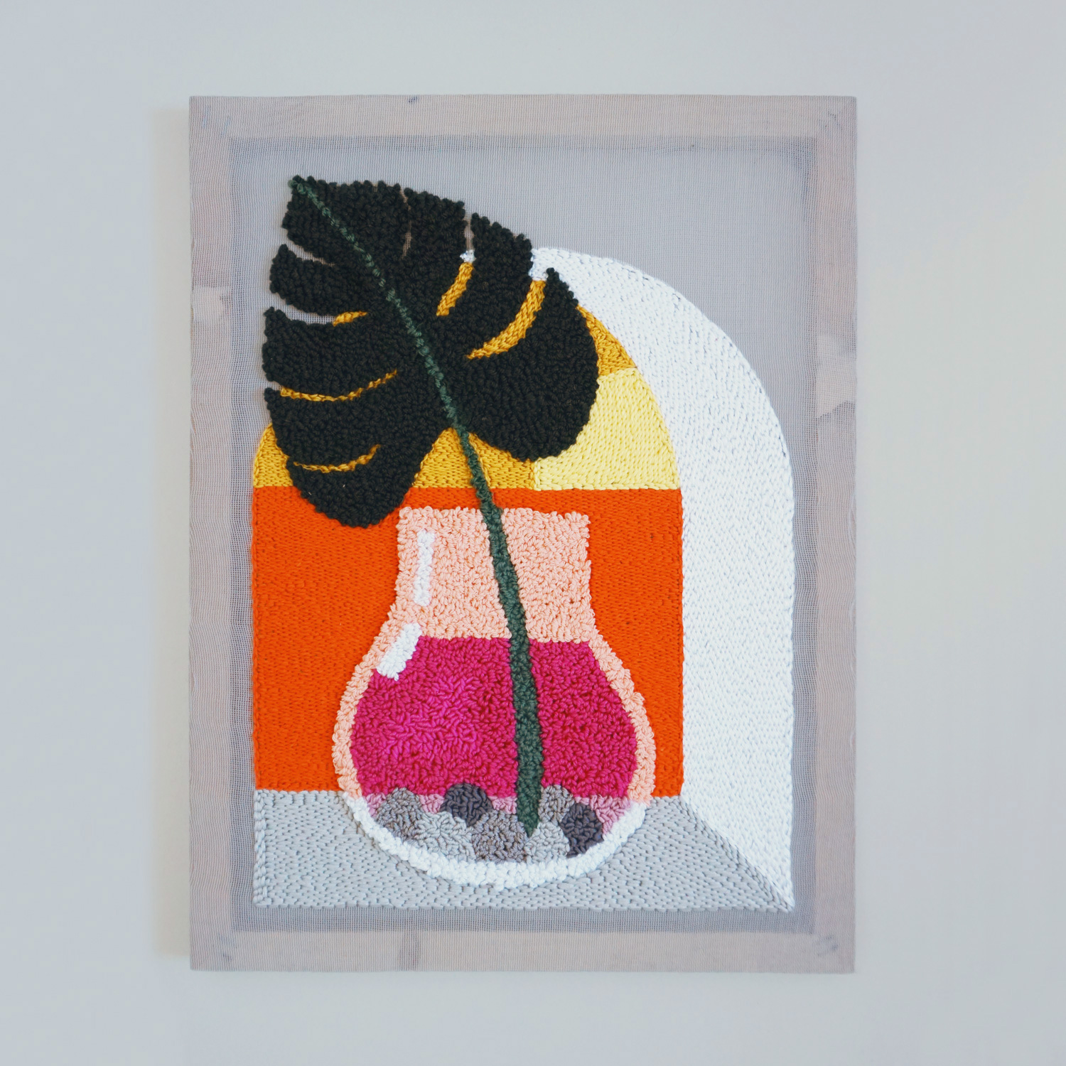 A pair of punch needle art works with a sunset view through arched windows, made on semi-translucent fabric.