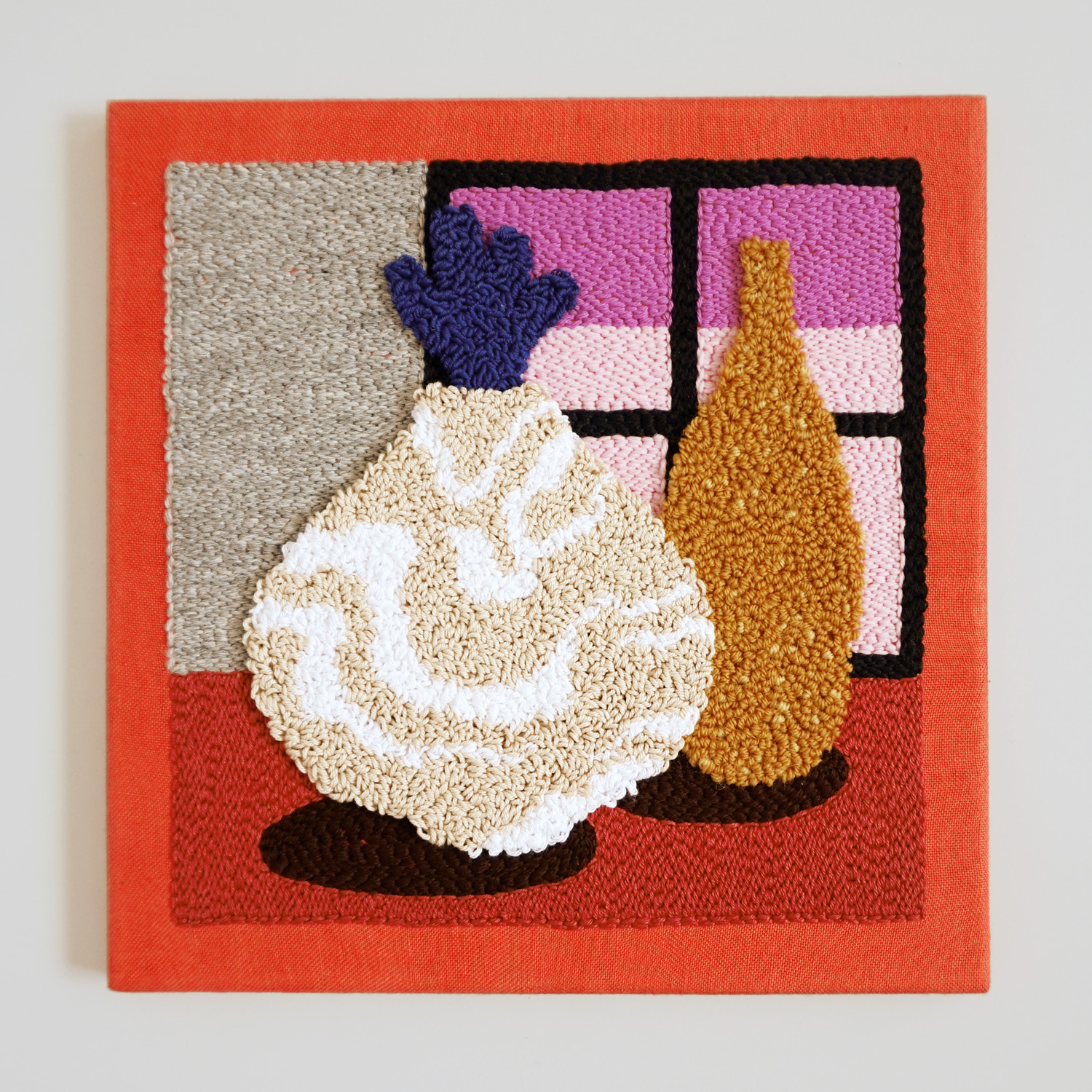 A soft punch needle mini artwork, featuring a marbled and speckled vase in front of a dusky pink sunrise window view.