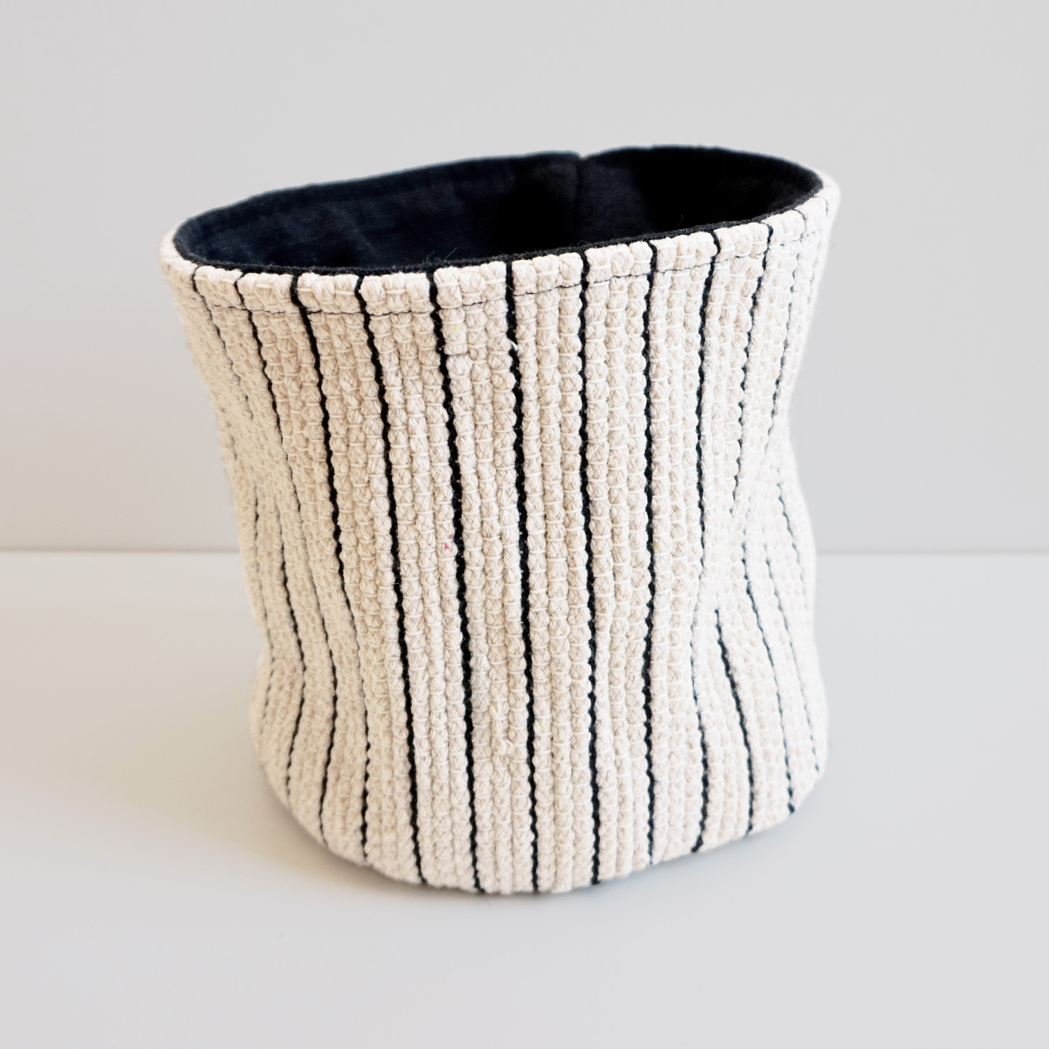 A small handy woven basket to keep all the little knicknacks around your house organized.