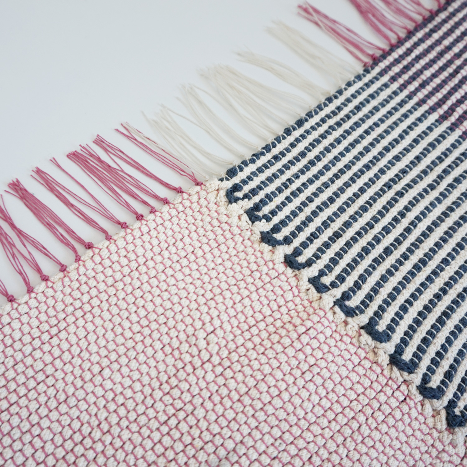 An extra large geometric carpet, woven from macrame rope and DIY crochet rope.