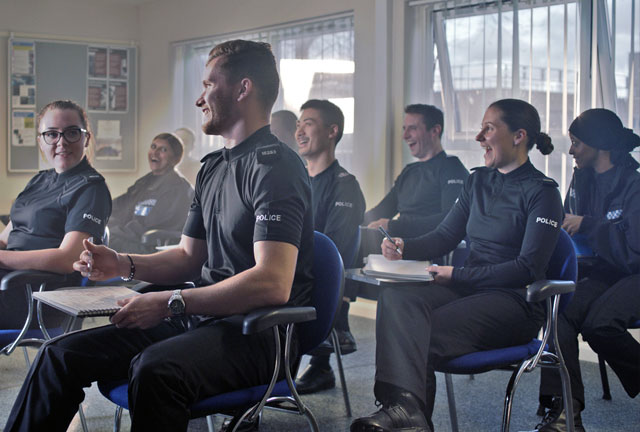 Picture from Kent Police of a police training classroom with student officers sitting at desks