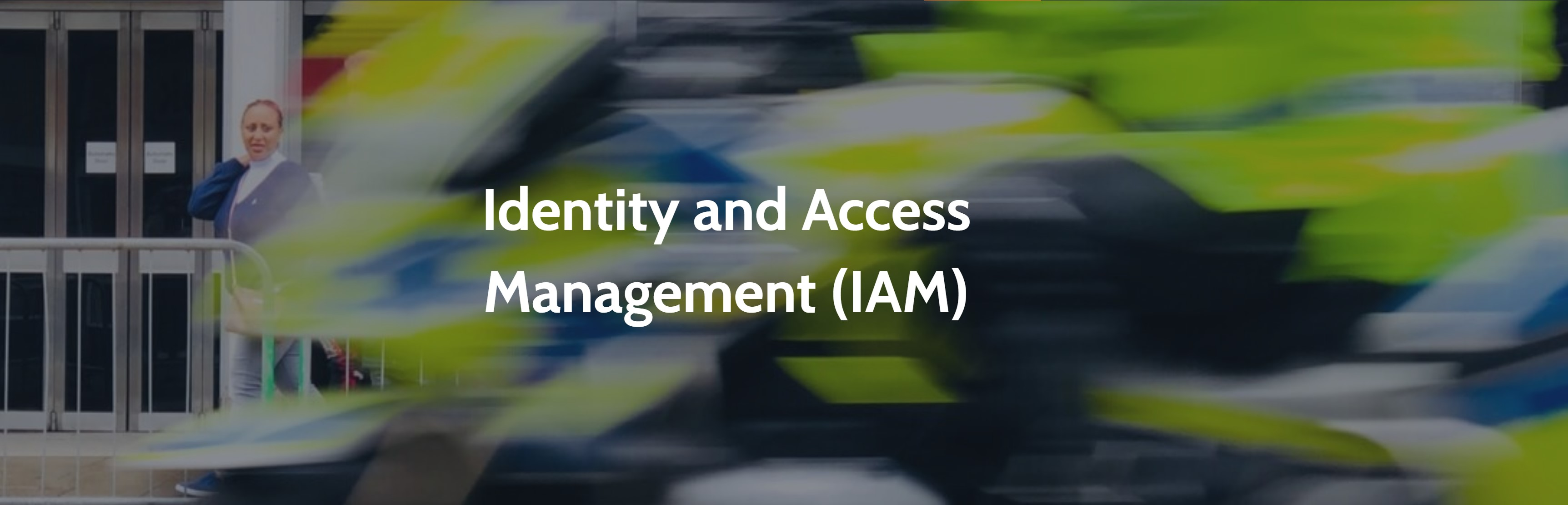 Blurred image of the police motorbike passing someone in the street with the words Identity Access Management across