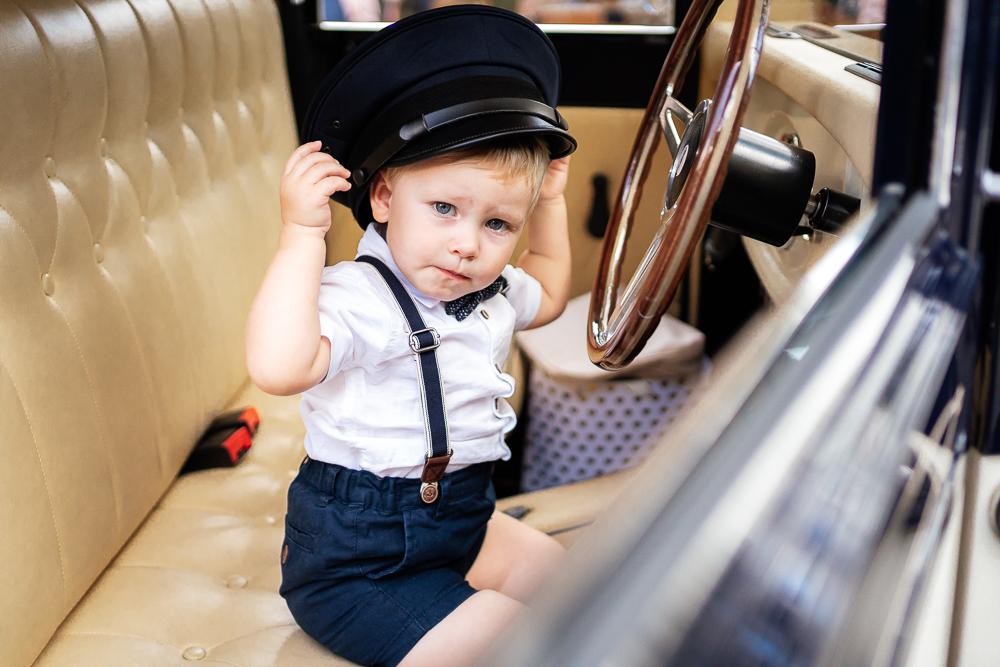 Young Boy driving the wedding car