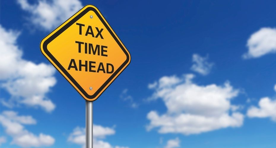 A traffic caution sign reads: Tax Time Ahead.