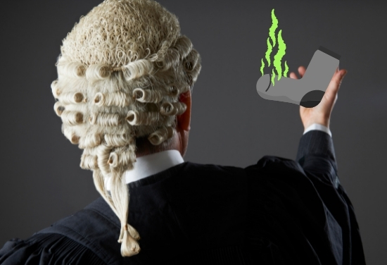 A barrister wearing an old-looking wig can be seen holding a smelly sock.