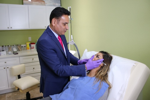 dr tamiry with a patient at his newport beach medical spa