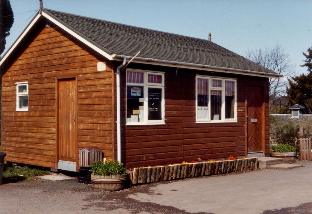 A picture of the old wooden clad office.
