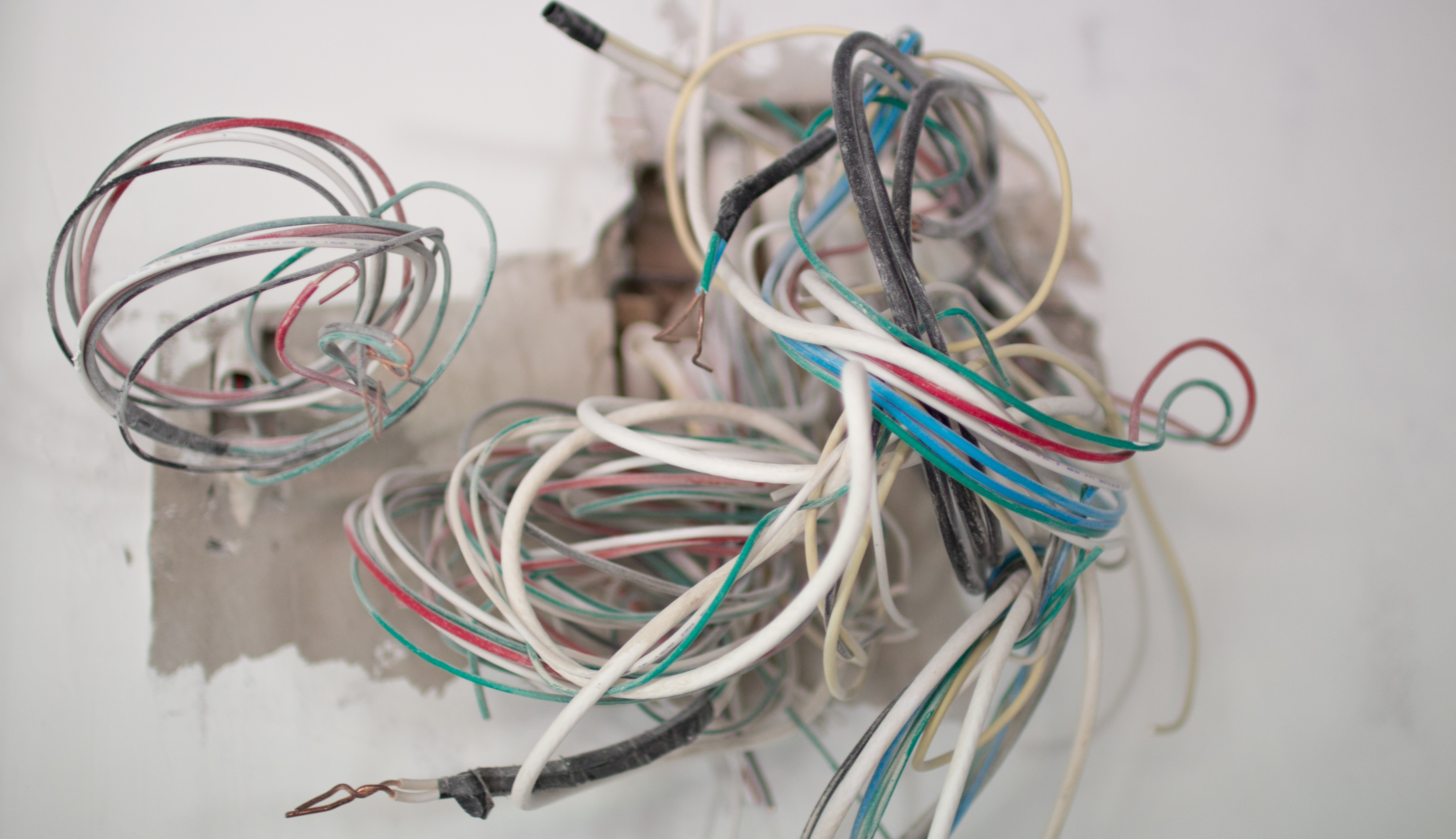 old cords out of a wall