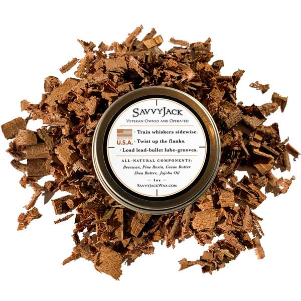 Strong hold SavvyJack mustache wax 1 oz tin. Back of mustache wax tin on wood chips.