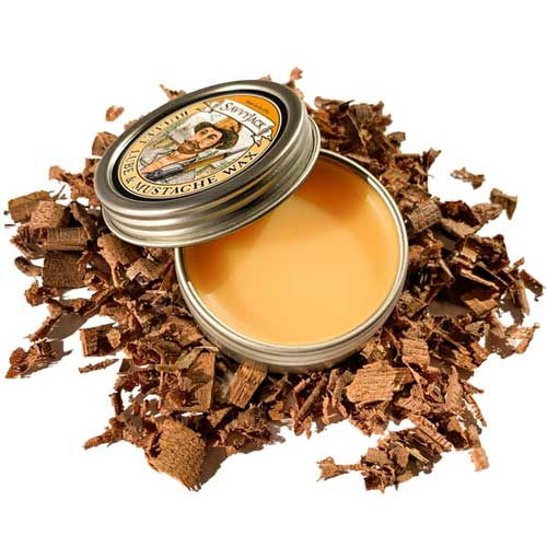 Strong hold SavvyJack mustache wax 1 oz tin. Open showing all natural golden color.