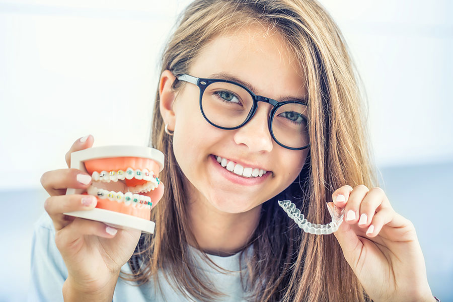Teen girl with clear braces