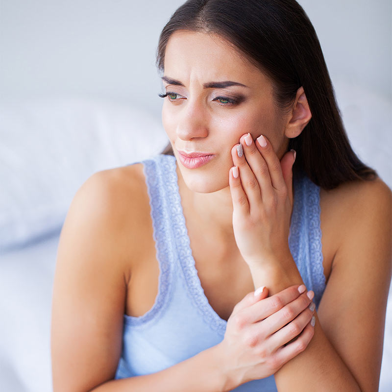 Girl with mouth pain