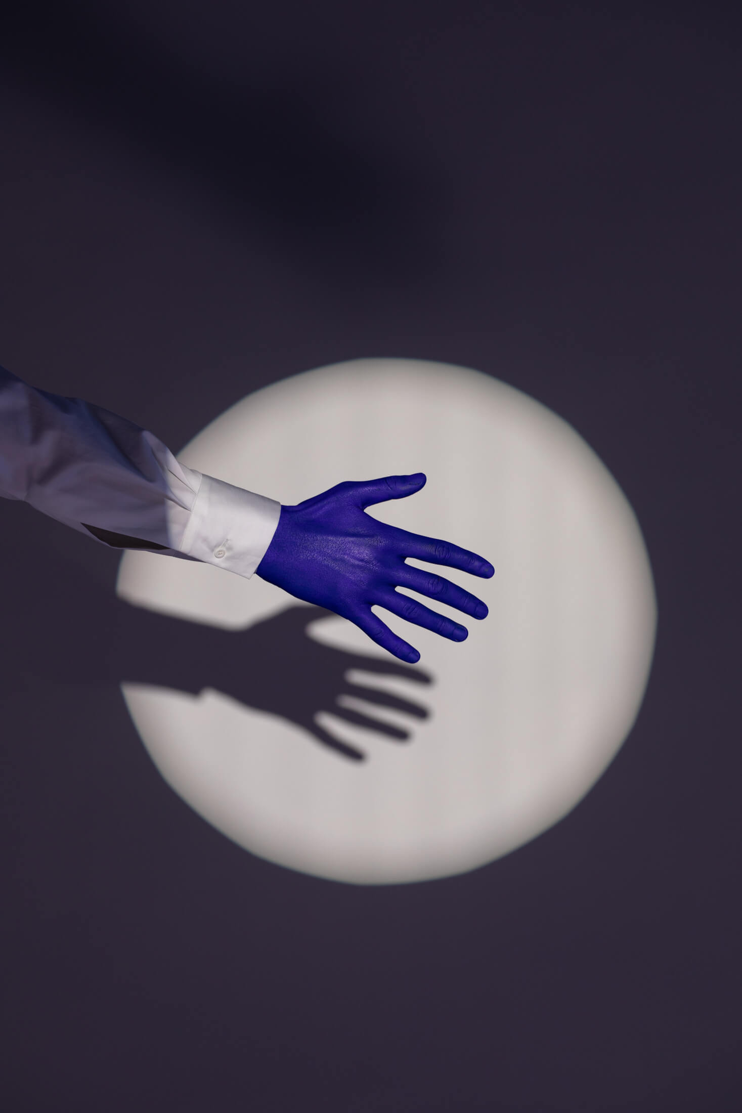 responsibility, highlighted blue hand, shadow