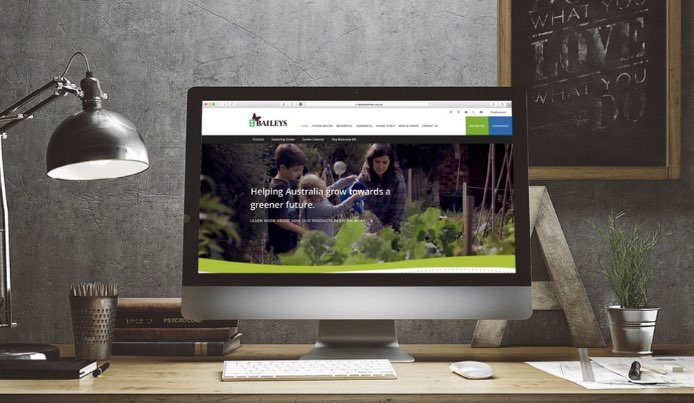 A computer displaying Baileys Fertiliser Website, which is designed by Flametree Creative, a leading perth web design agency.