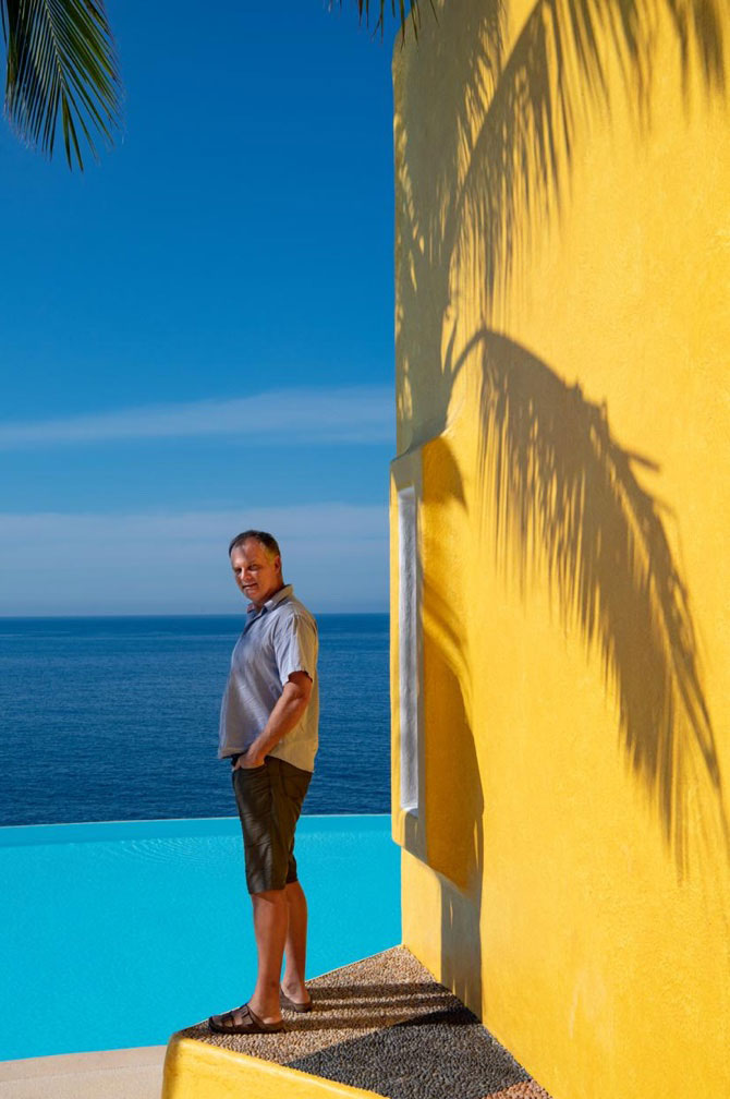Jorg standing by a pool