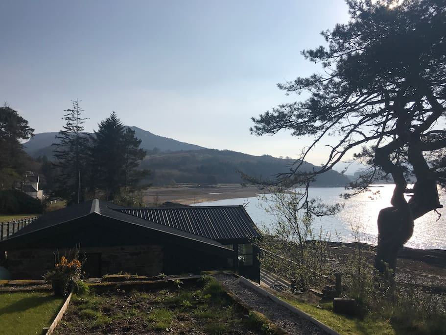 Self catering Chalet with large private deck, meters from the shore line with breath taking views across Loch Alsh overlooking the Isle of Skye