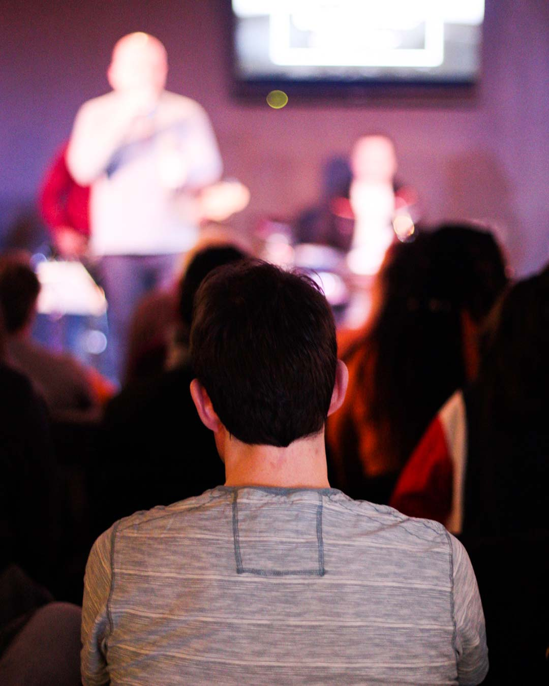 A church member seated in a church service.