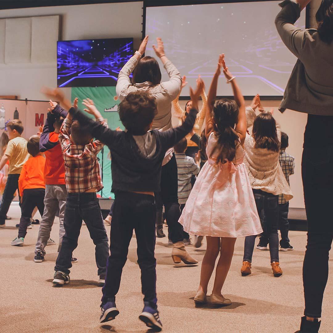 Children dancing in a hall.