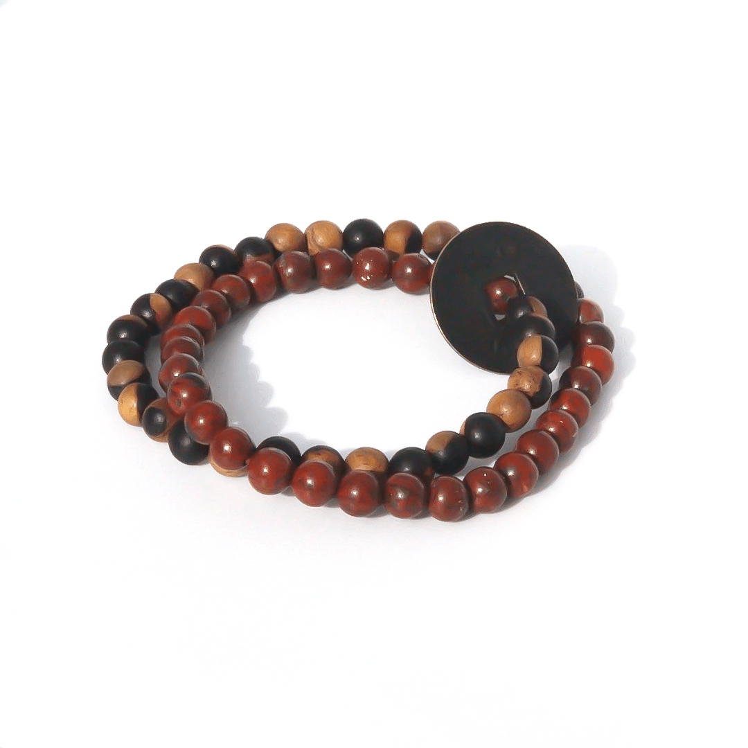 Product Description: yin yang sandalwood complimented by brecciated jasper & a Chinese vintage coin