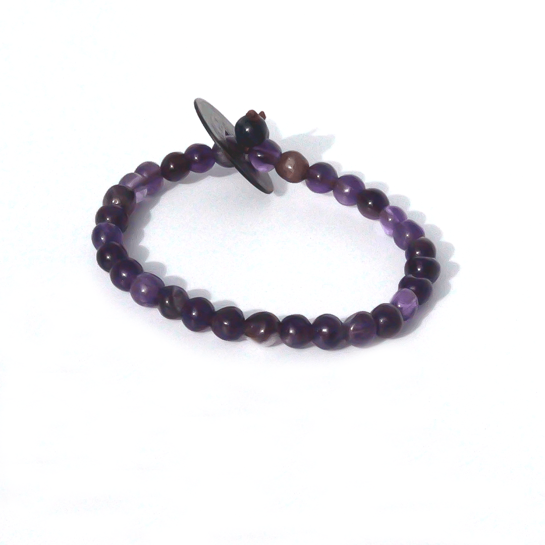 Product Description: Amethyst complimented by dumortierite & a Chinese vintage coin