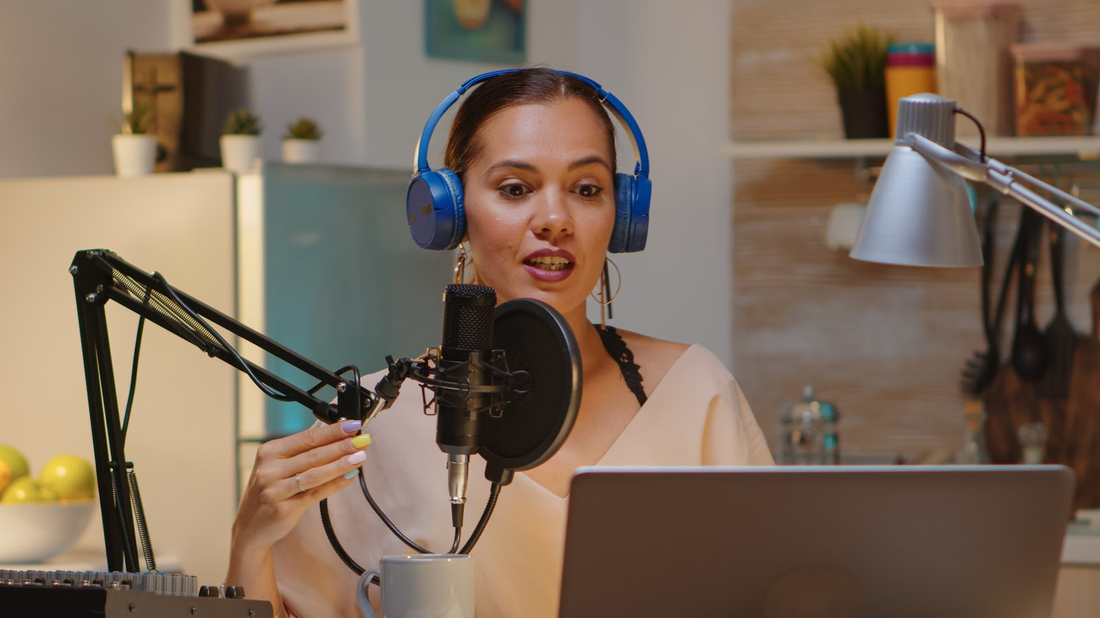 Girl with headphones recording a podcast