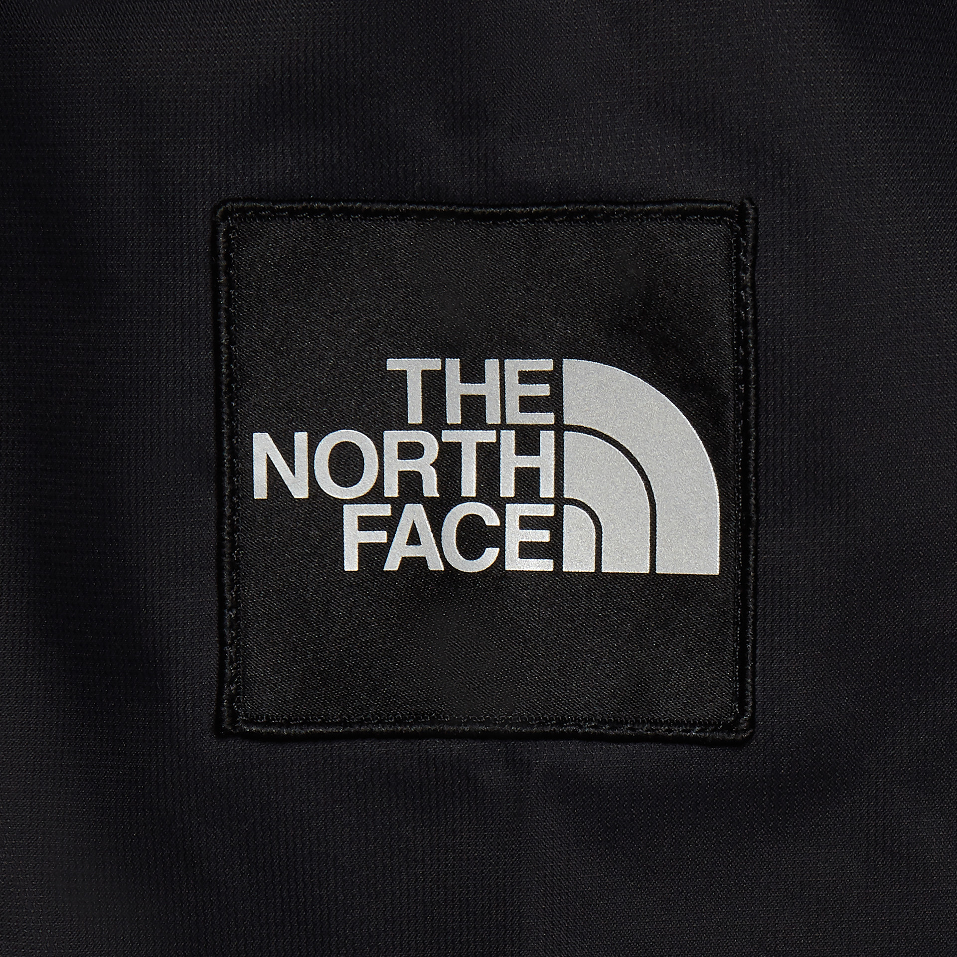 The North Face logo detail of the jumper photography