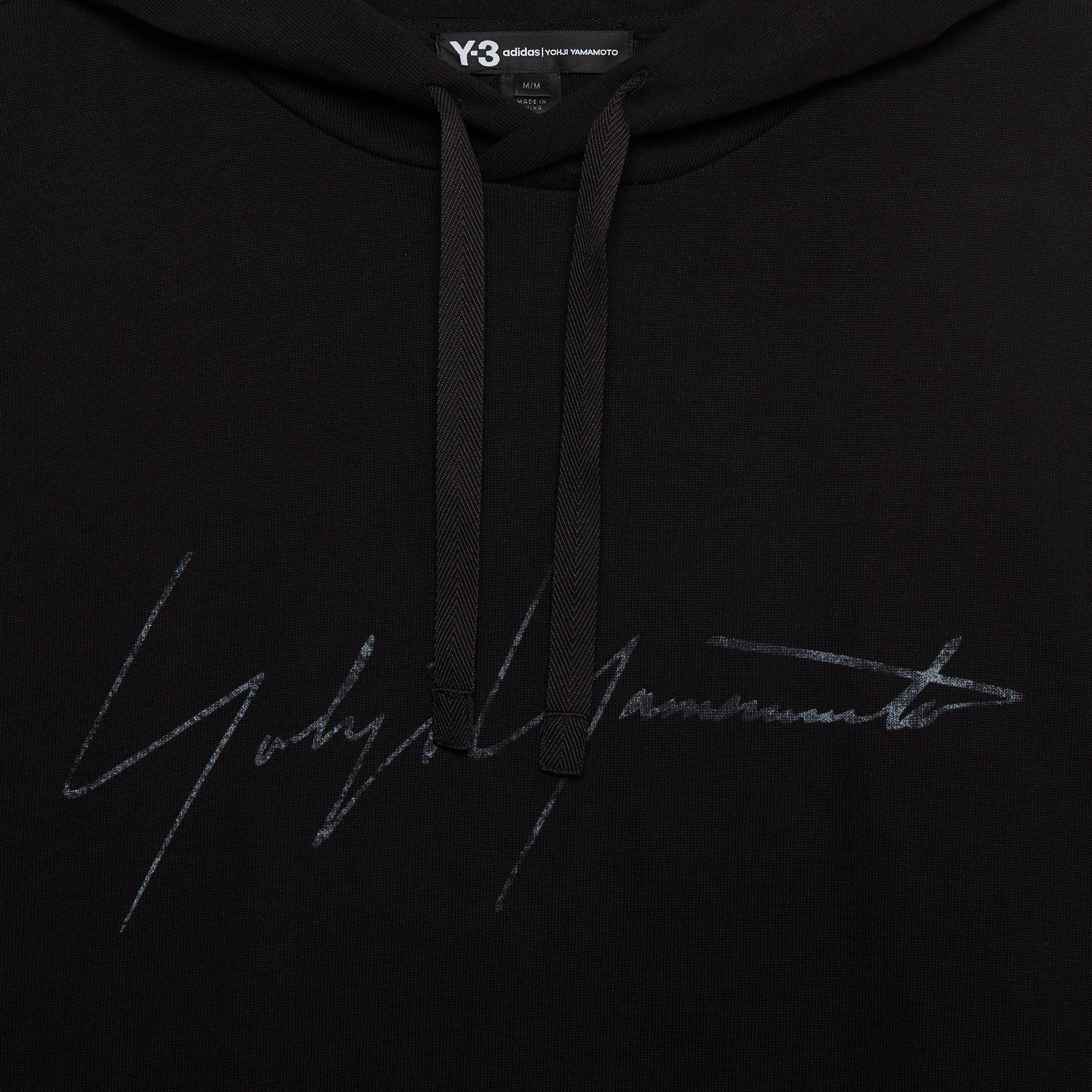 close up detail of a black sweat jumper
