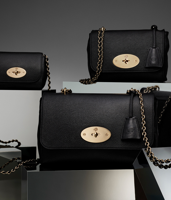 Packshot of three mulberry handbags in black on white reflective background
