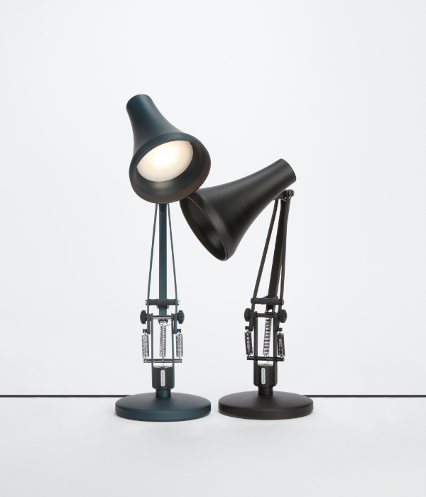 Two Anglepoise lamps on light grey background