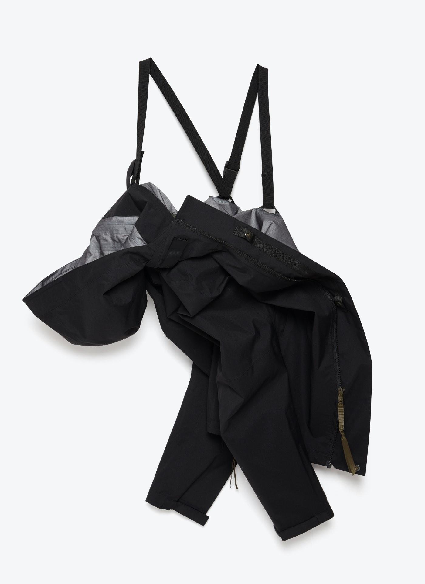 creative shot of a hanging black and grey coat jacket