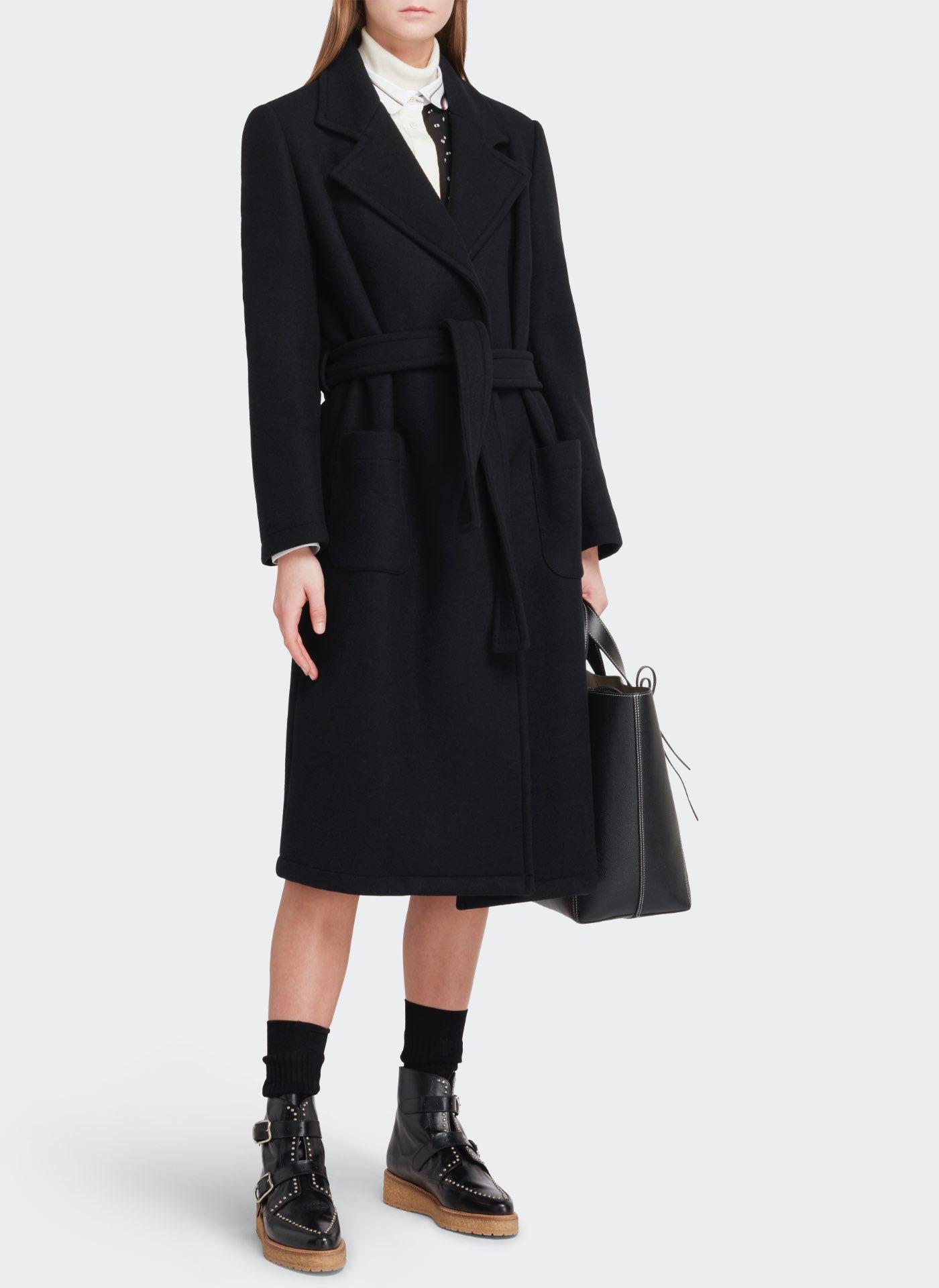 Womenswear model wearing black J&M Dress with a black leather bag