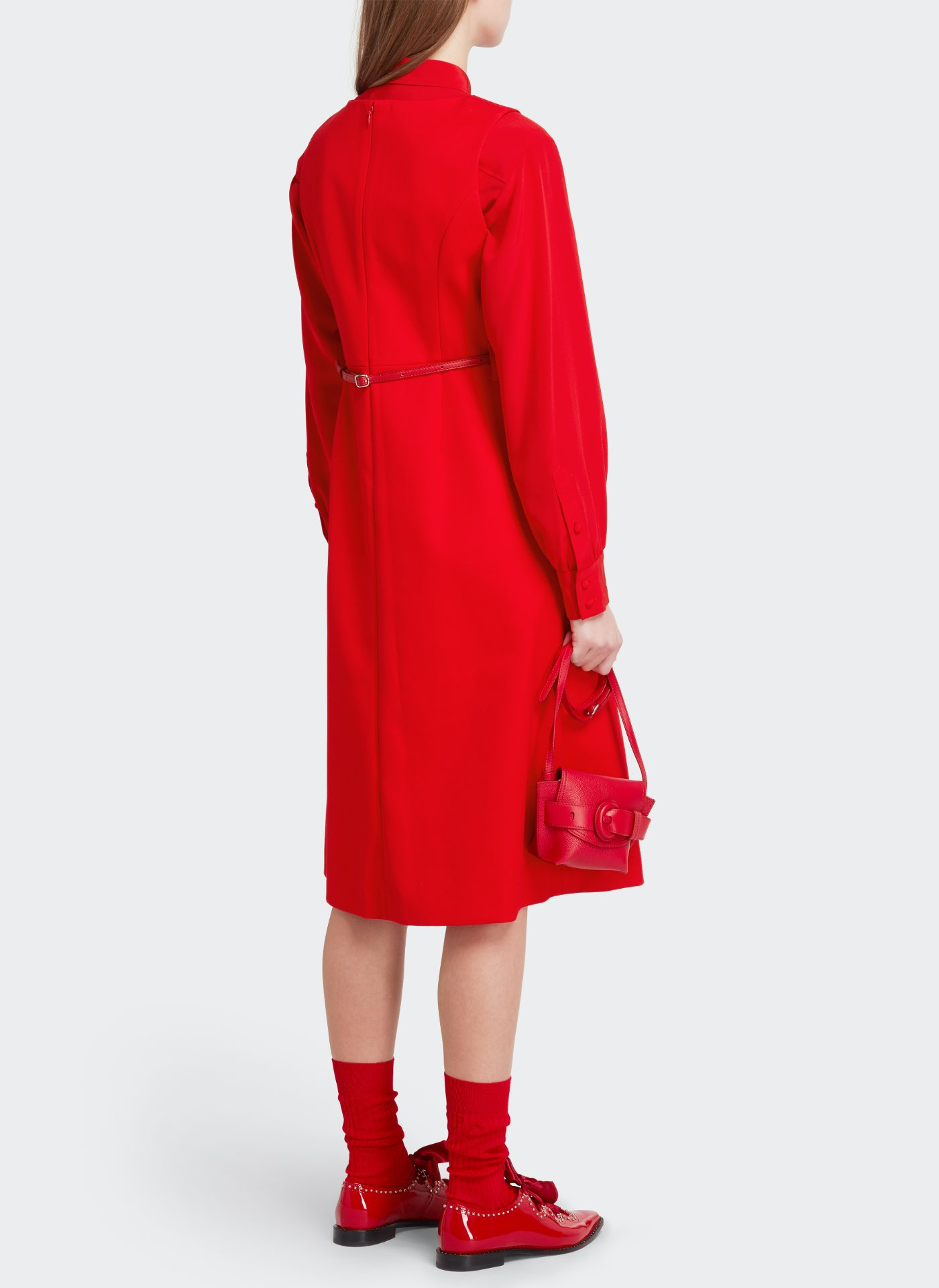 Womenswear model wearing red J&M dress with a red leather bag, red shoes and red belt, red socks
