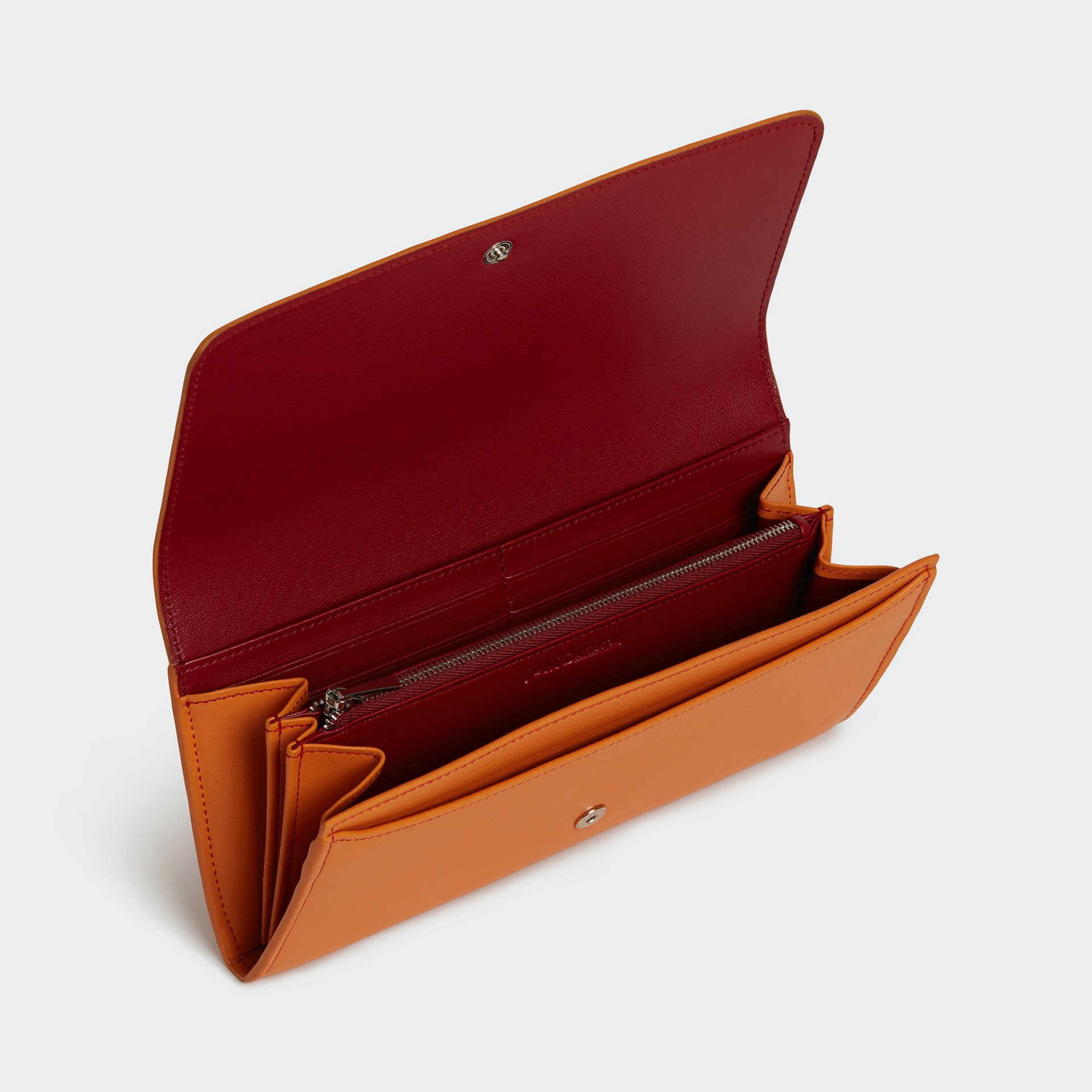 J&M purse in orange with deep red inside