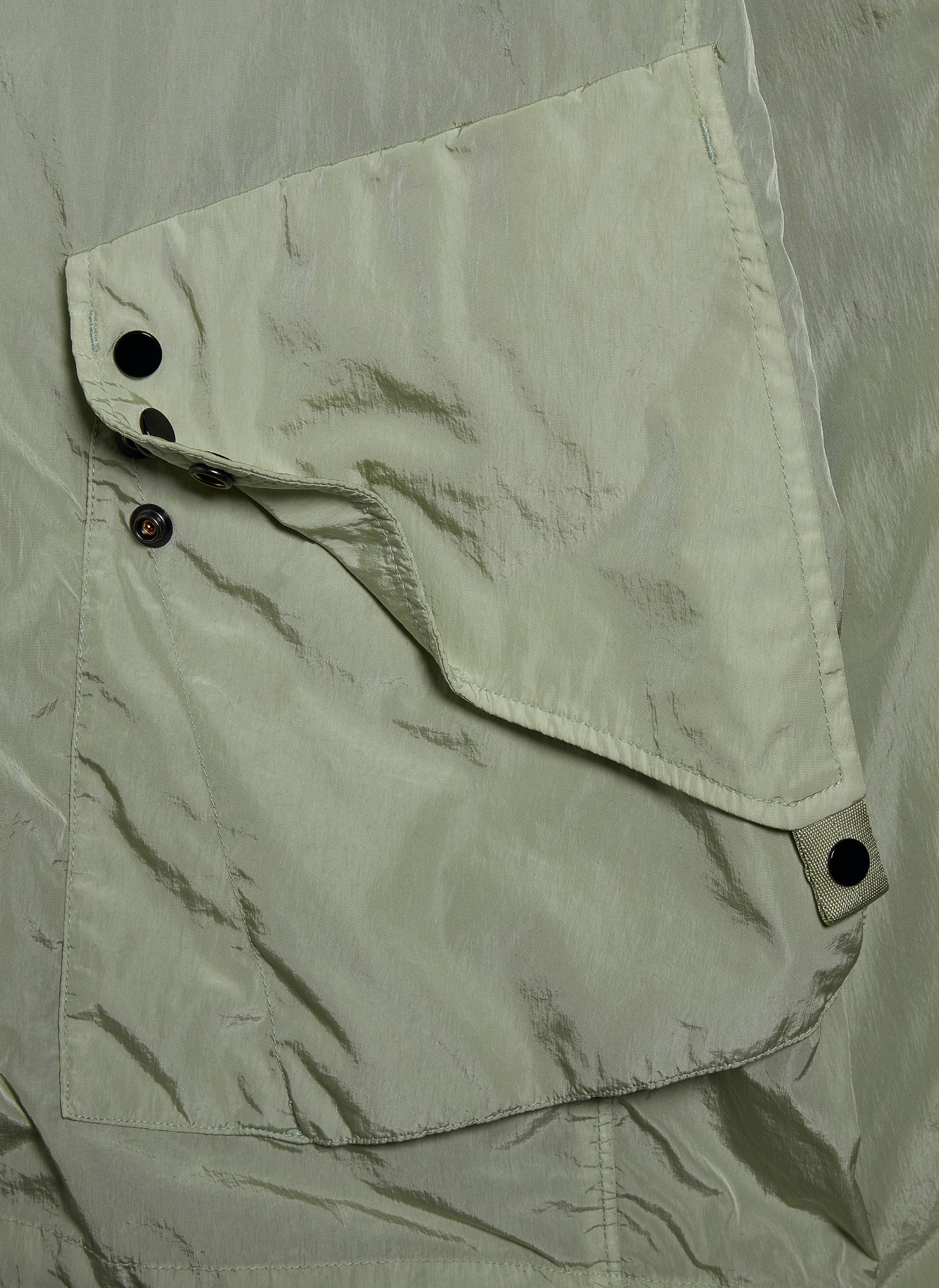 Pocket shot of a light green grey C.P. Jacket Rain coat