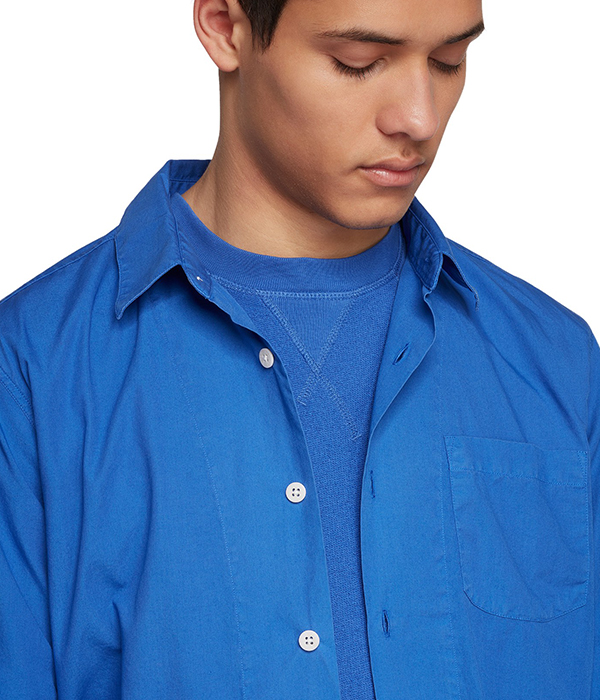 Portrait of a menswear model wearing blue t-shirt and blue over shirt
