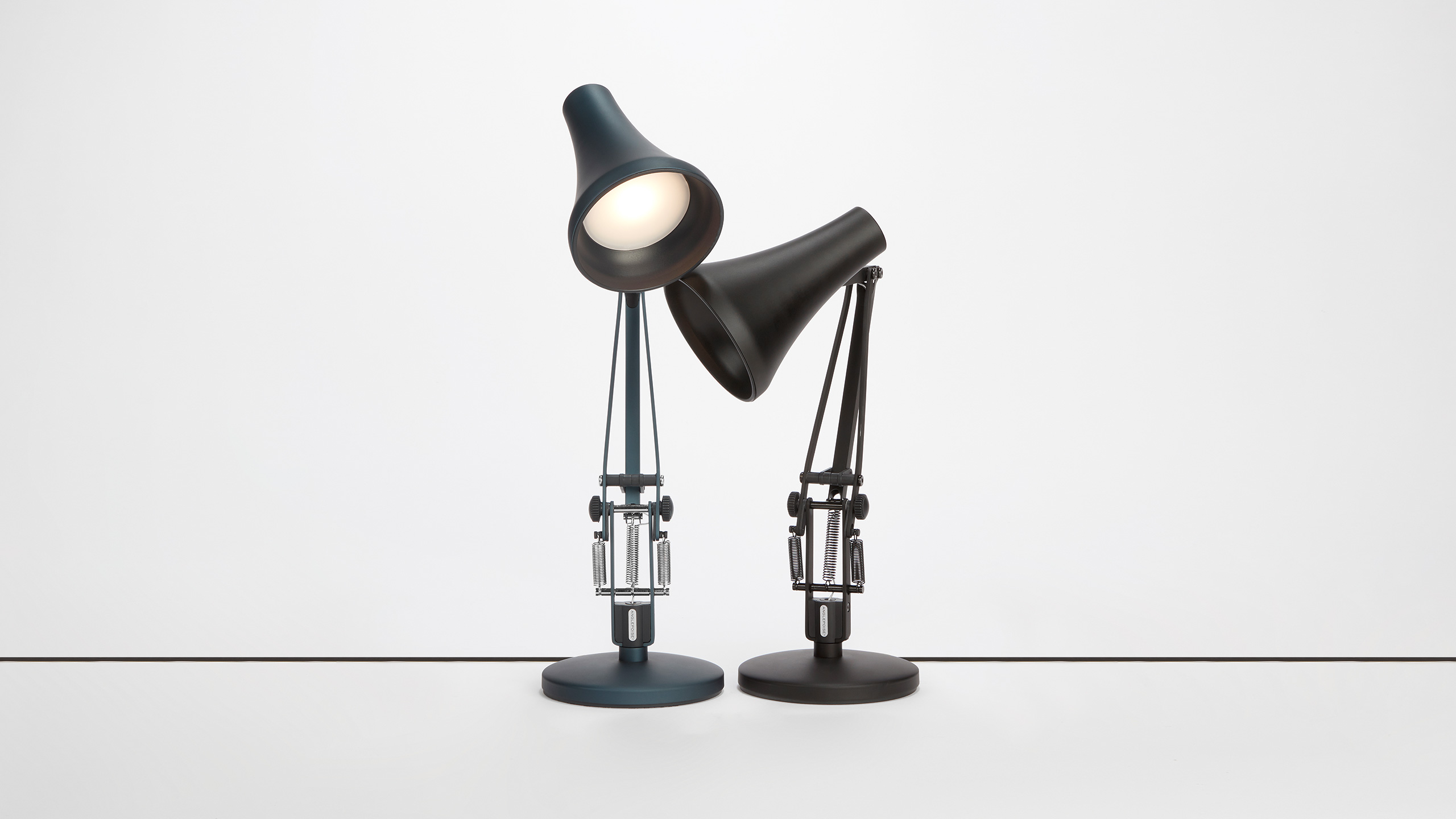 two desk lamps by Anglepoise