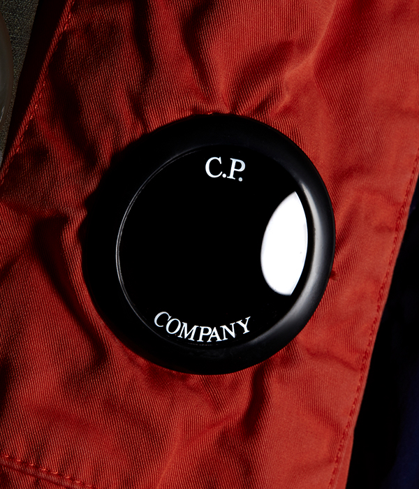 close up shot of C.P. branding on a red jacket