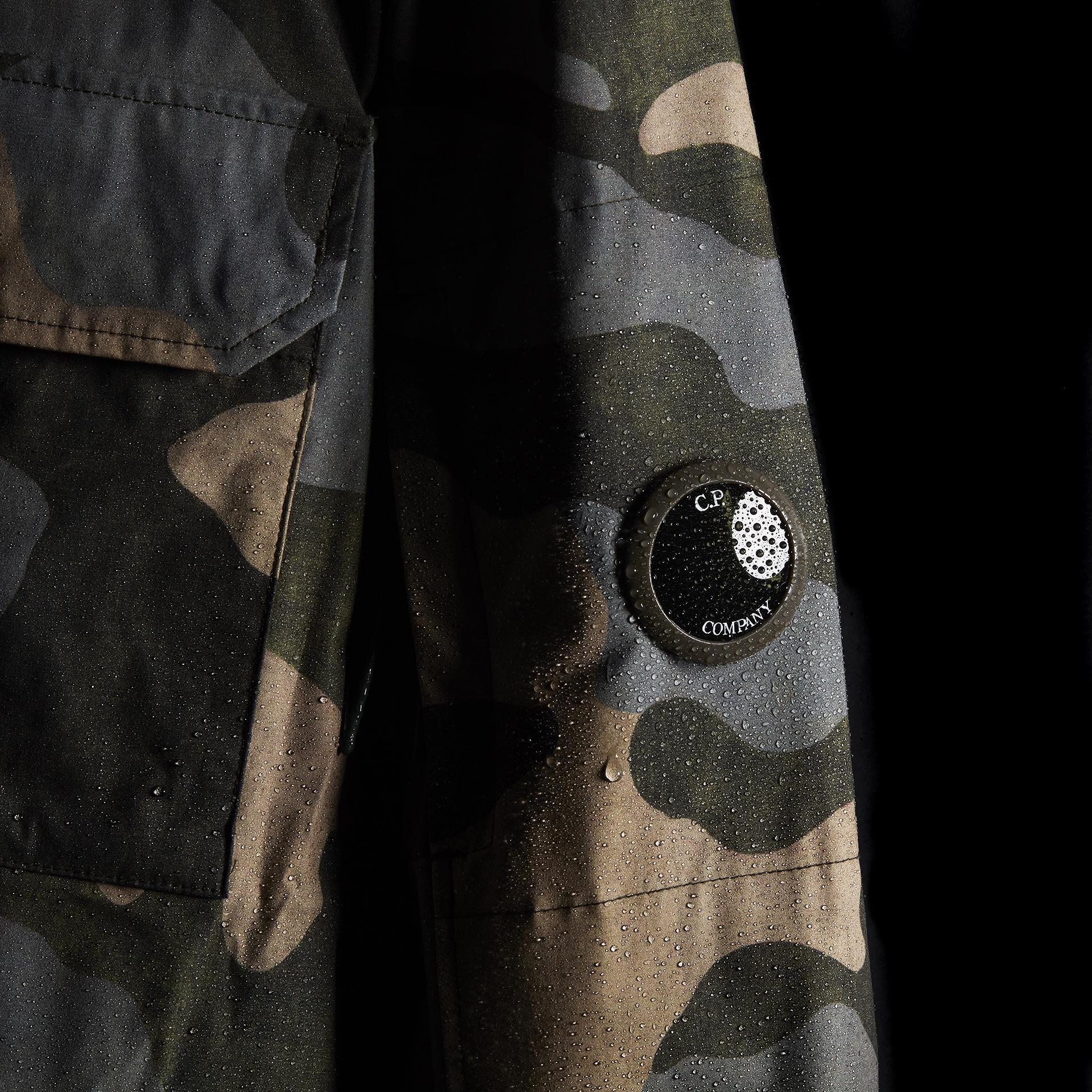 Camo C.P. Company jacket on black side background