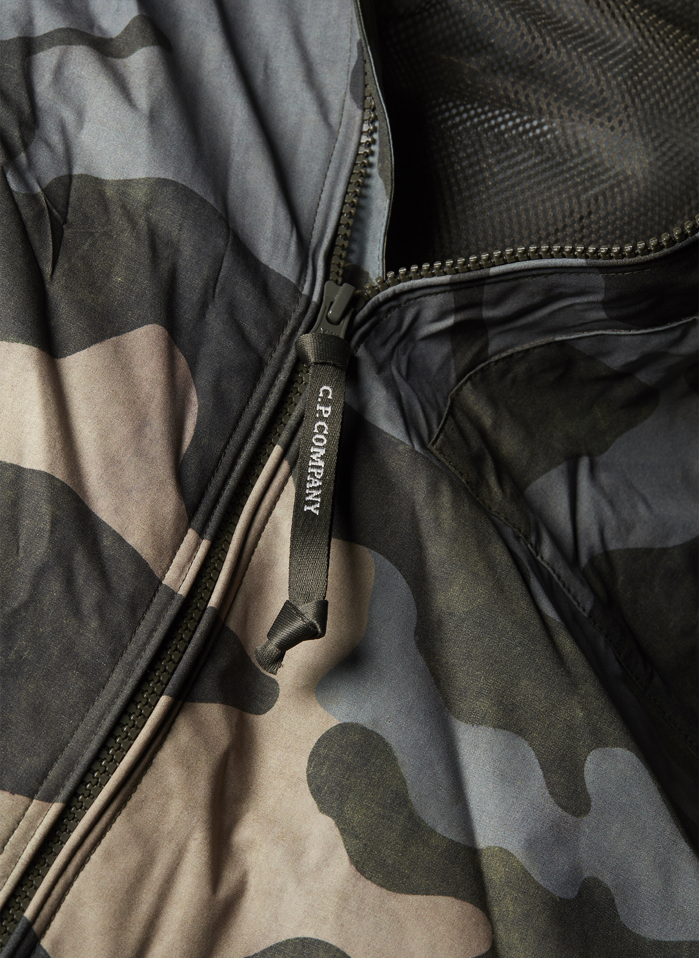 Detail shot of a zipper and collar of a Camo C.P. Company jacket
