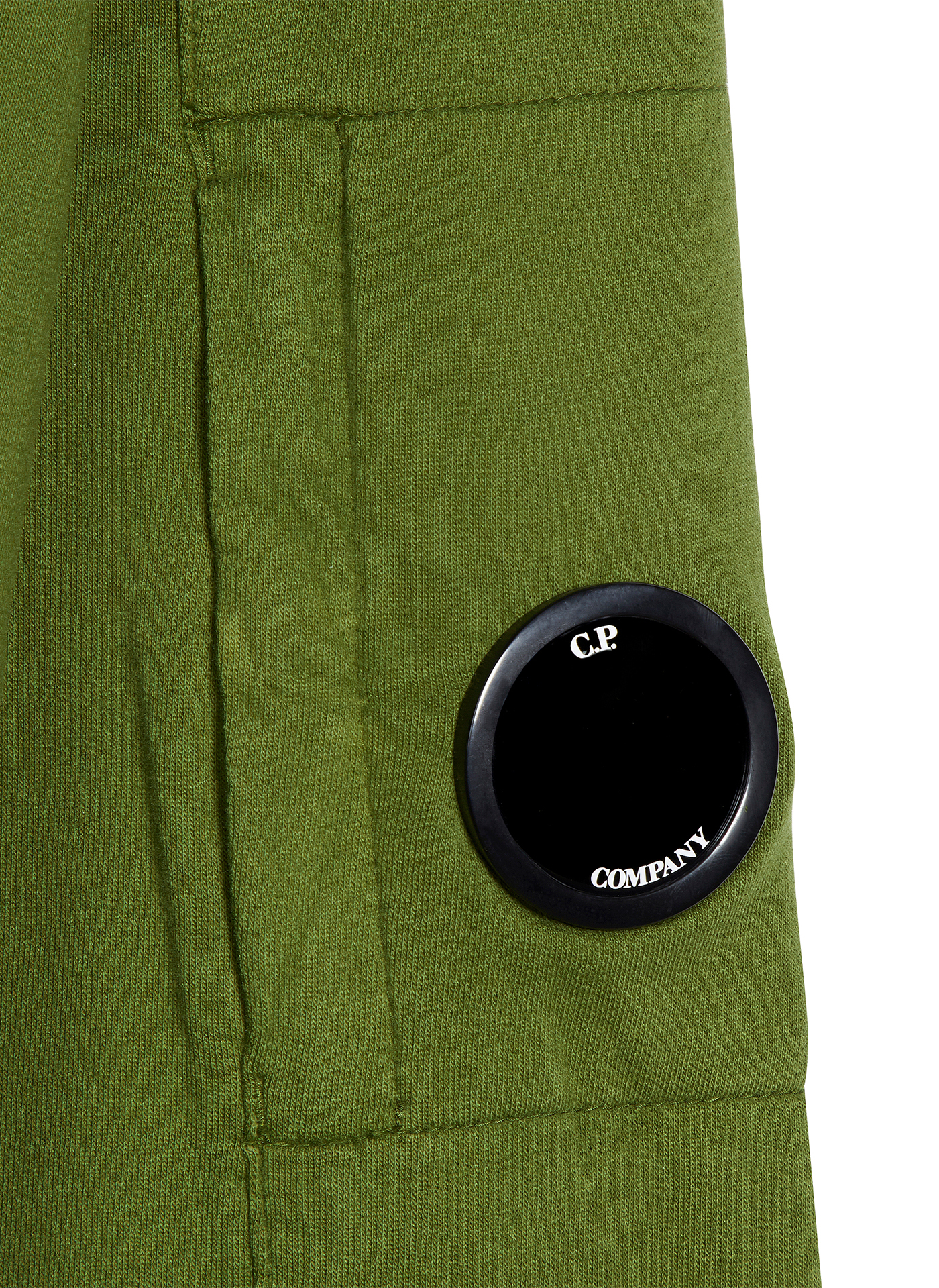 Green C.P. Company jumper detail shot of the sleeve and black logo