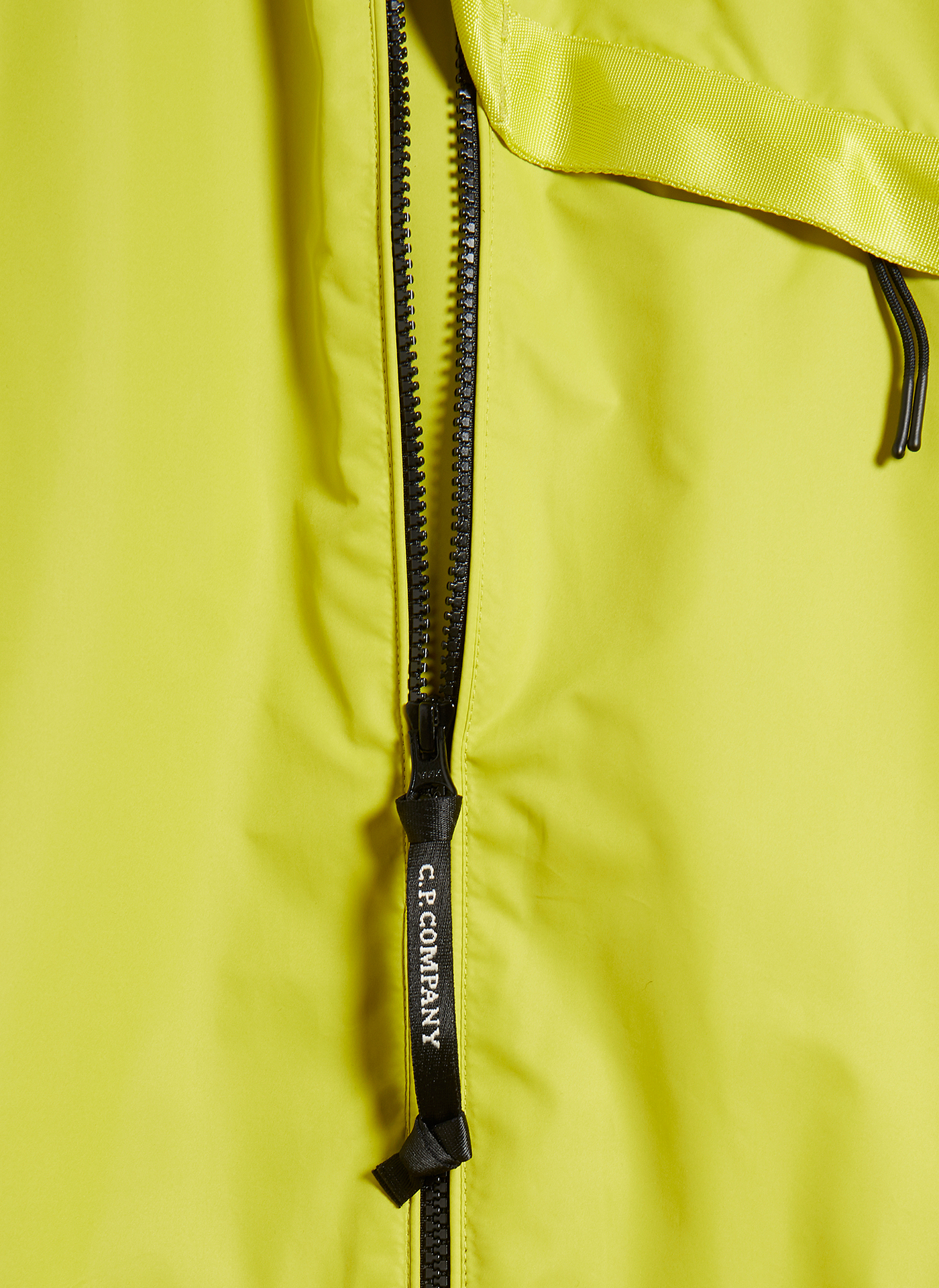 Detail shot of a black zipper of a Bright yellow C.P. Company jacket
