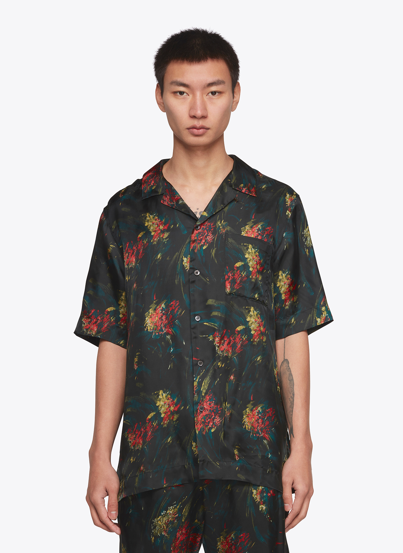 t-shirt with floral pattern worn by a menswear model
