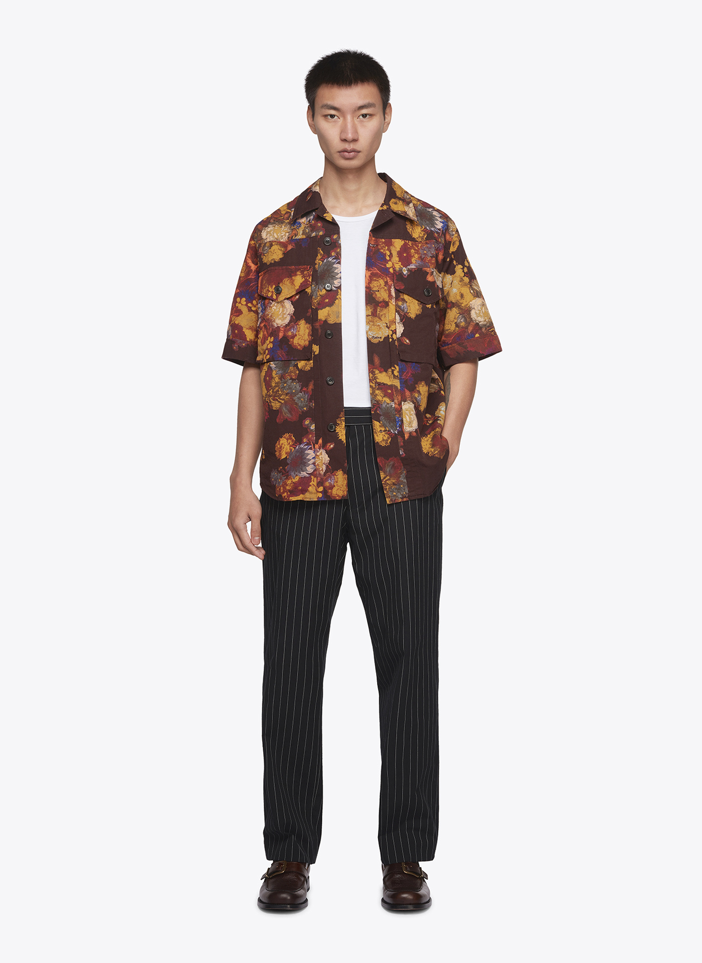 menswear model wearing floral shirt and black trousers