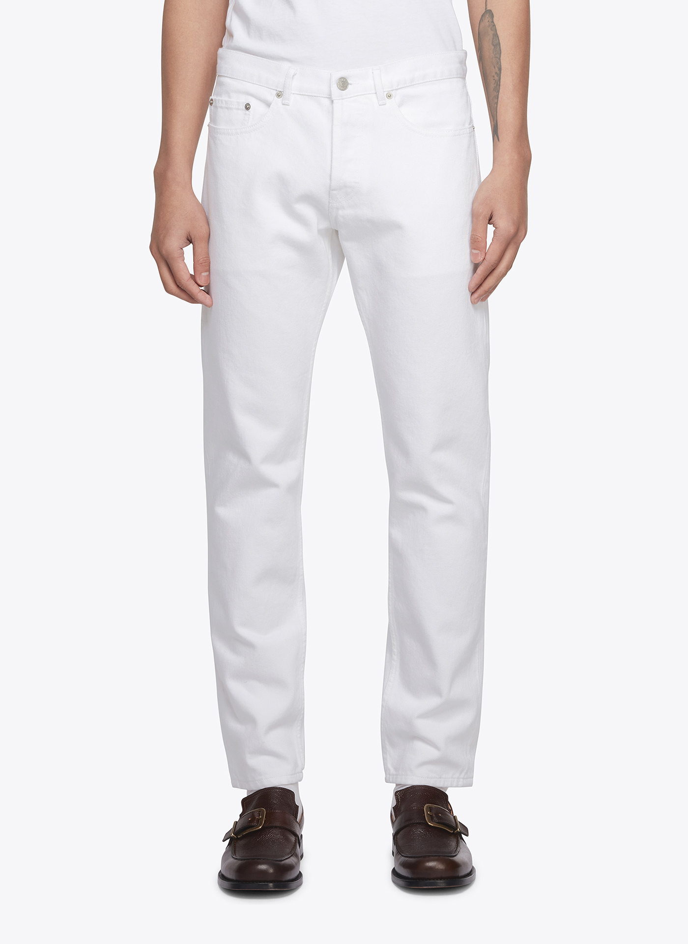 white denim trousers worn by a menswear model