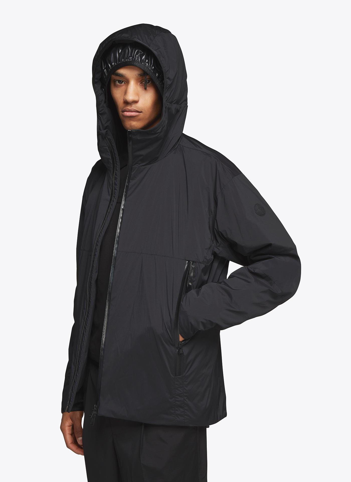 menswear model wearing dark blue coat with hoodie on