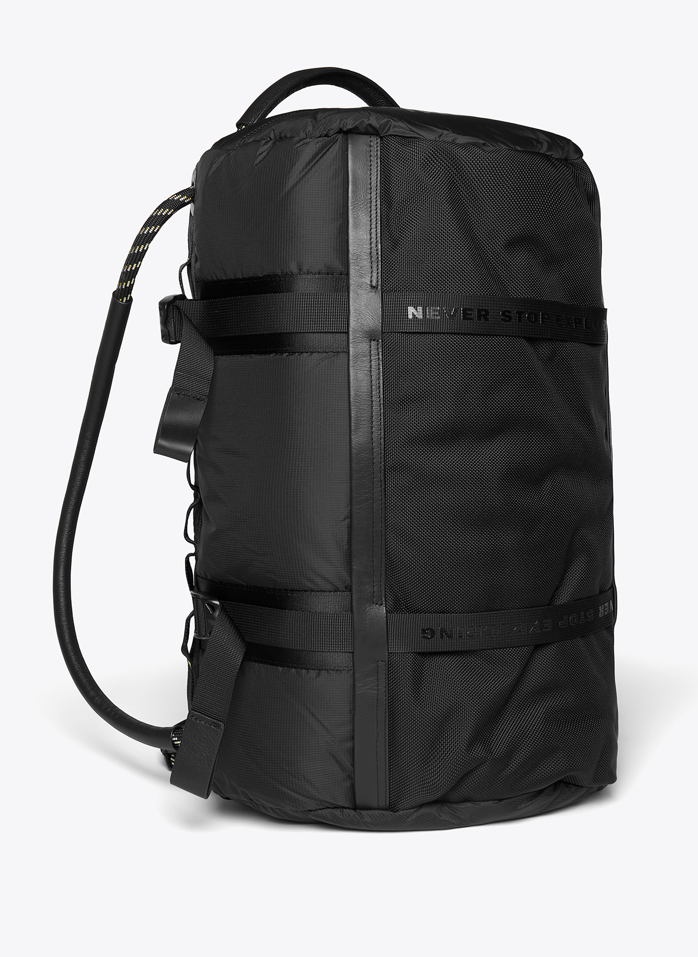 black backpack shot from the side on a white background