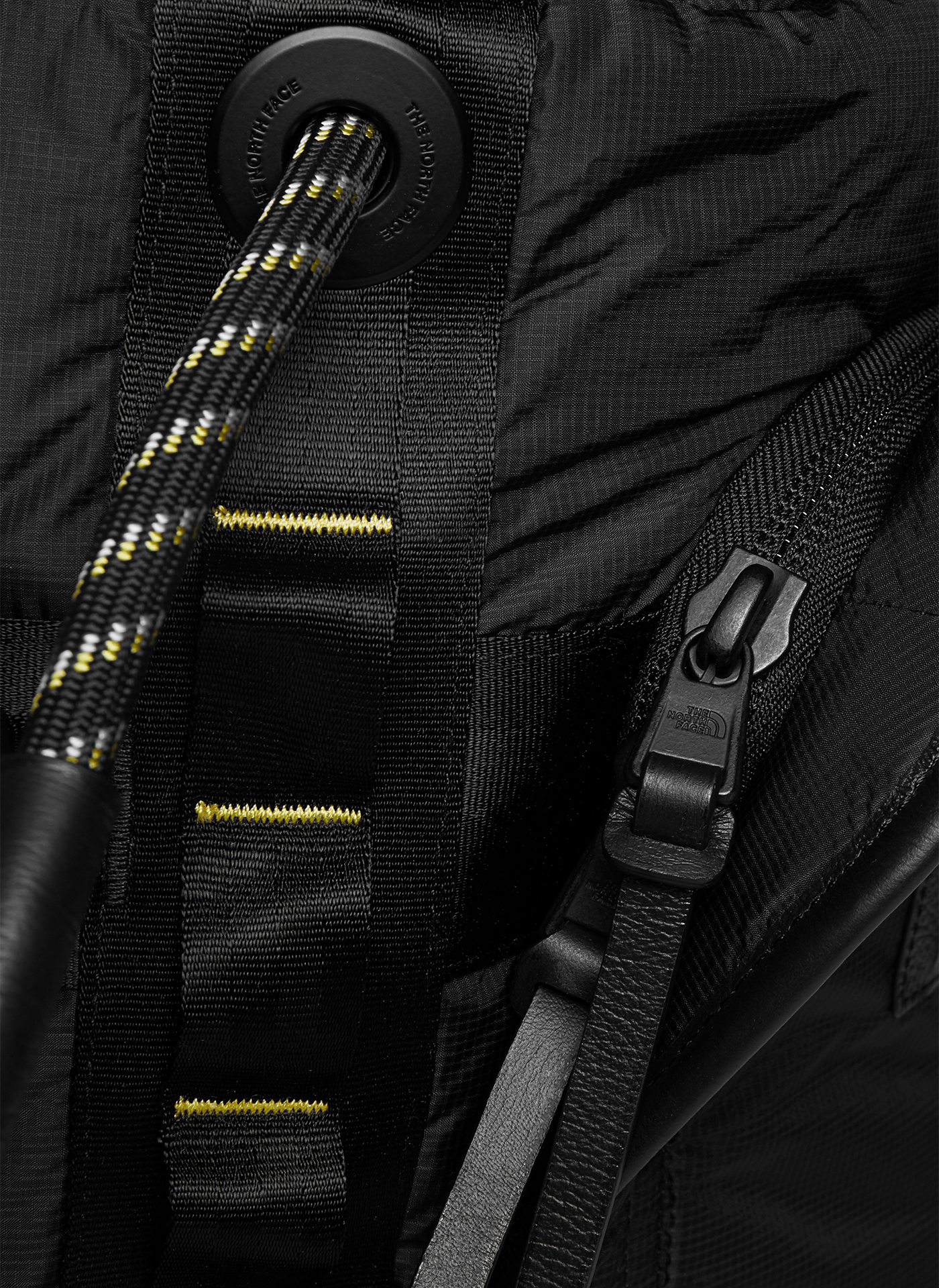 close up shot of a zipper from the black backpack