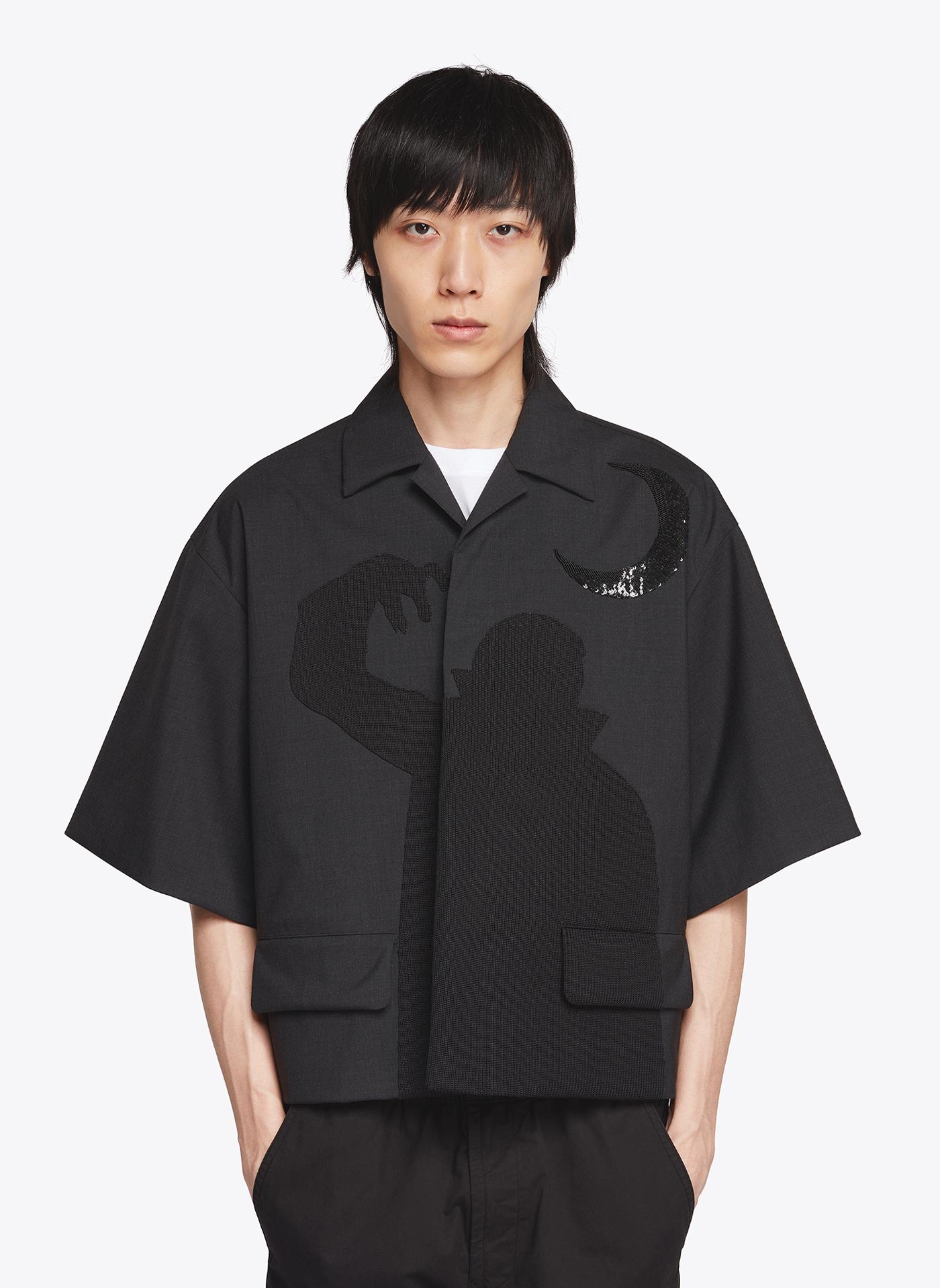 menswear model wearing wide black t-shirt