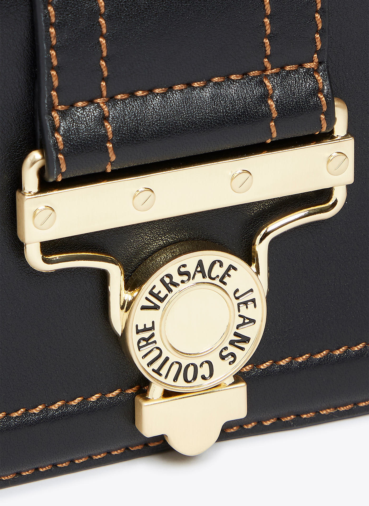 close up of the shot of black and gold versace handbag