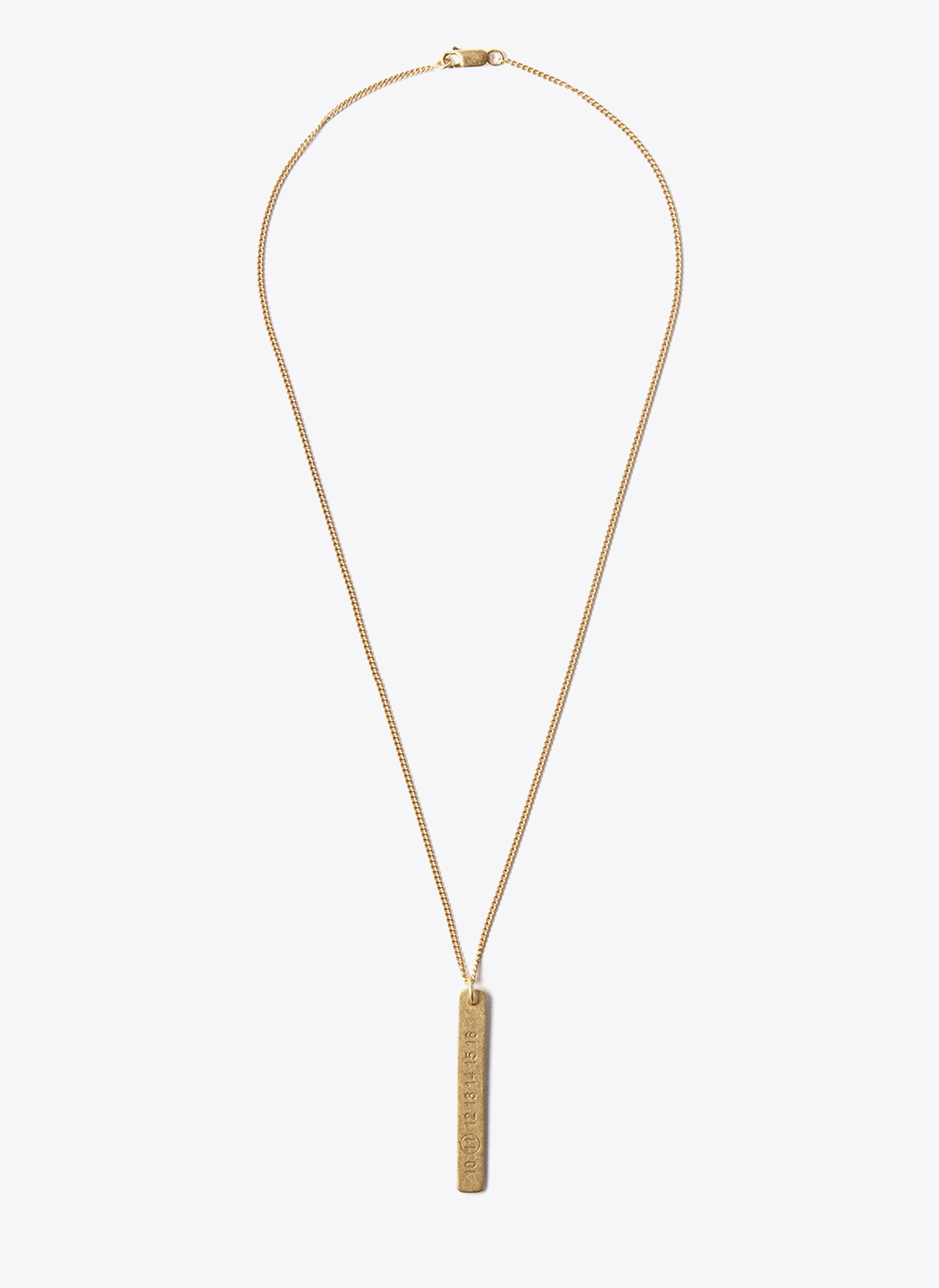 gold necklace on white background